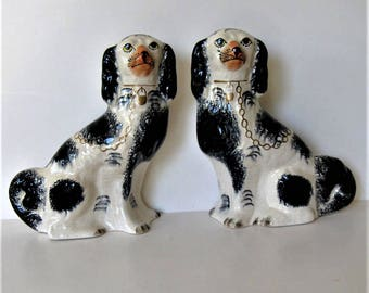 """2 Stafforshire ceramic Wally mantle dogs, vintage spaniels, Made in England, black and white crackle, 7 1/2"""" tall, gold chain, gift idea"""