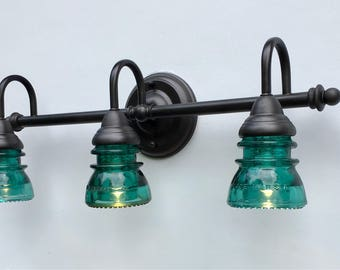 3-light Bathroom Vanity Fixture with Clear Vintage Glass Insulators with an Oil-rubbed Bronze or Matte Black finish