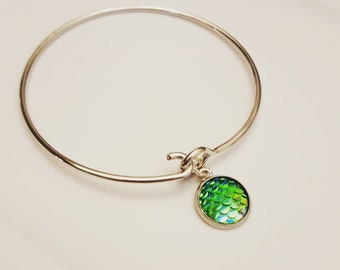 silver bangle with mermaid scales charm
