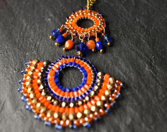 A Beautiful Cobalt and tangerine Sautoir Necklace made with czech glass crystals, seed beads, gold tone copper necklace, brickstiched