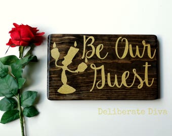 """12  inch long """"Be Our Guest"""" solid wood sign with glittery gold lettering hand crafted inspired by Beauty and The Beast"""