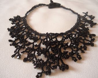 Black 'coral' necklace with seed beads