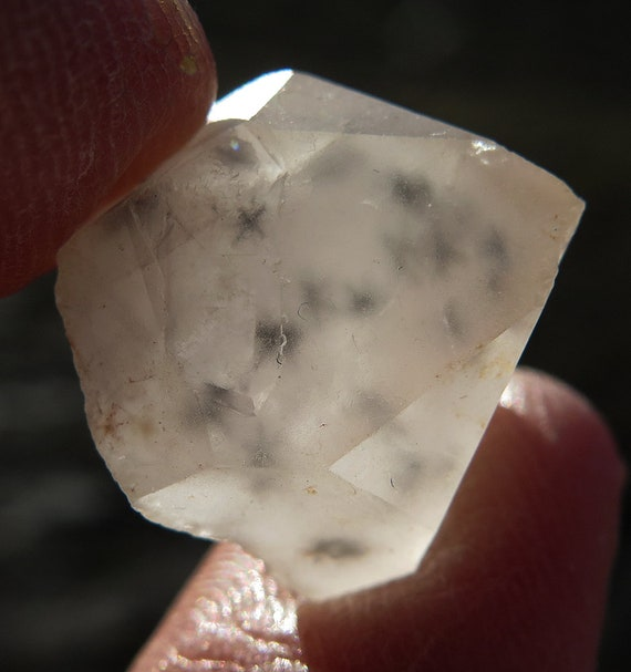 30 Carat Hollandite star included quartz. Self healed floater. Many stars deep within this crystal. Old Madagascar
