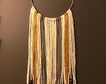 Yarn and hoop wall hanging