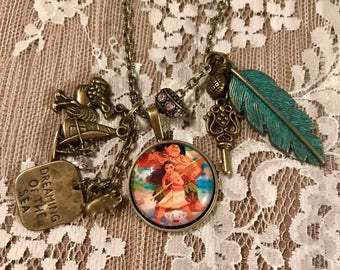 """Antique Bronze Tone, Pendant Necklace With Charms.  """" Moana and Maui."""""""
