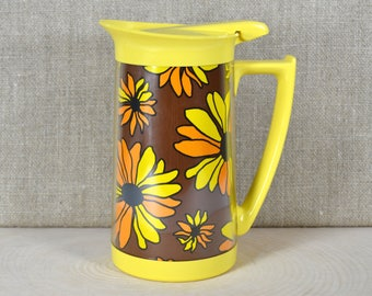 Vintage West Bend Thermo-Serv Pitcher, 1970s Yellow Plastic Insulated Carafe w Lid, Covered Milk Jug, Brown w Yellow & Orange MOD Daisies