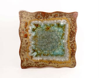 Square tray in rustic copper brown glaze with sparkly blue glass center and wavy edge