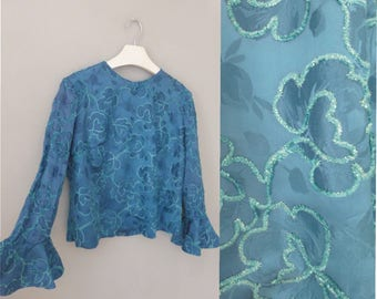 90s floral blouse. XL size. Blue petrol satin blouse with beautiful long bell sleeves & embossed flowers. In a very good vintage condition.