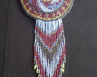 Beaded Barrette, Spiral Design around a Buffalo Head Nickel Button, maroon, various shades of blue.