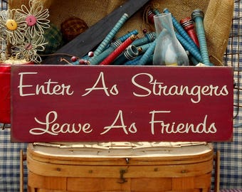 Enter As Strangers Leave As Friends painted primitive rustic wood sign