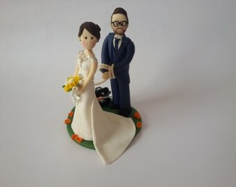 Custom made bride dragging groom  wedding cake topper