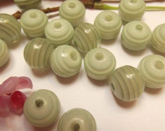 set of 18 green plastic beads
