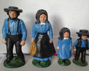 set of Amish family cast iron figurines.
