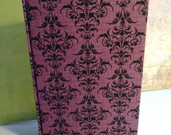 Blank journal with purple/black fabric cover.