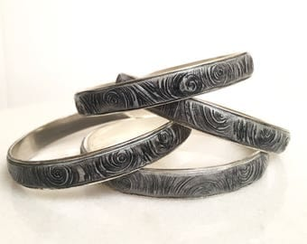 Ebb & flow bangle, silver with swirls pattern in shades of black