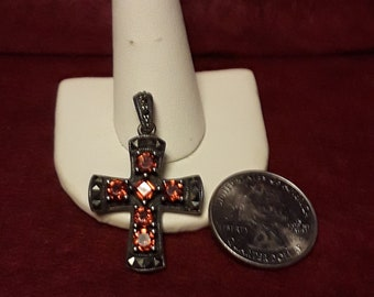 Orange Sesspatine garnet & Marcesite Sterling silver cross pendant.