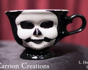 143 - Creepy Ceramic Doll Faced Teacup with Hand Painted Skull design,  3 inches tall