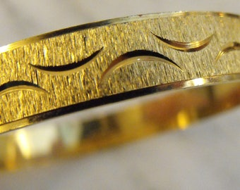 Gold tone Bangle Bracelet by Anson