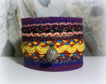 textile jewelry / ethnic bracelet/cuff/stripes and embroidery on purple felt