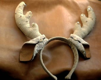 Headbend Deer, Tiara, headdress, hair style.