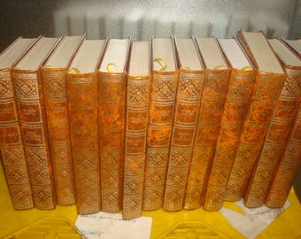 Set of 13 Wilbur Smith Vinyl covered books by Heron Books.