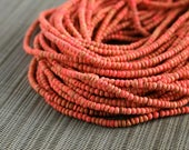 2-3mm Salmon / Coral Coconut Shell Pucalet Rondelle Beads Dyed and Waxed 15 inch strand