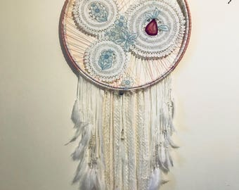 Handmade wall hanging with crochet lace