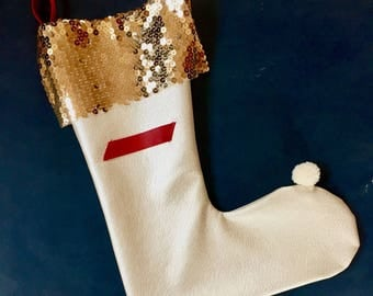 Christmas stocking.Luxury christmas stocking. Sequins. Pearl white leather. Decoration of fireplace. Christmas time.Gift stocks.