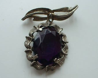 Vintage bow brooch with large faceted glass pendant