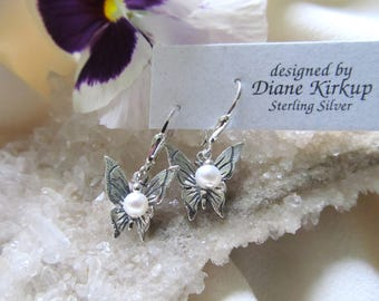 Sterling Silver Butterfly Earrings Presented on Sterling Silver Lever Back Findings Accented With A Swarovski Crystal Drop
