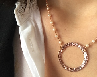 Necklaces with rosary brass chains and hammered circles in rosé silver
