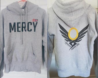"Overwatch - Mercy - Women's Military Style Hooded Sweatshirt - ""Heroes Never Die"""