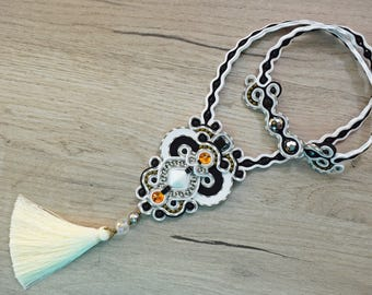 Black and white soutache necklace with tassel.