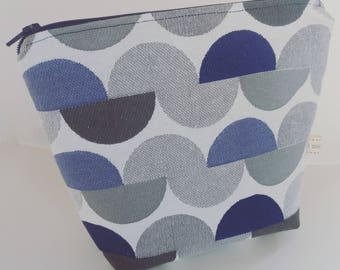 Pouch bag with blue grey background
