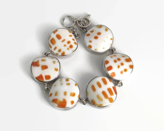 Sterling silver link bracelet with 6 large white and orange ceramic circles that look like Mitra Mitra or Miter shell, 8.25 inches, 38 grams