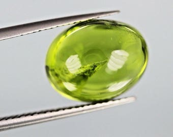 8.05ct top green color,Oval cut peridot Cabochon From Pakistan.