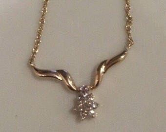 14k Gold between 1/5 and 1/4TCW Diamond Cluster Flower Necklace