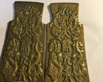 Pair of Chinese brass plaques