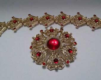 Vintage gold, red rhinestone sarah coventry floral filigree brooch and bracelet set