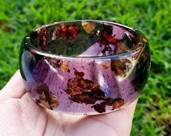 Bangle bracelet  made with eco resin, black ink and copper and gold leaf.