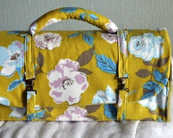 green floral satchel style bag
