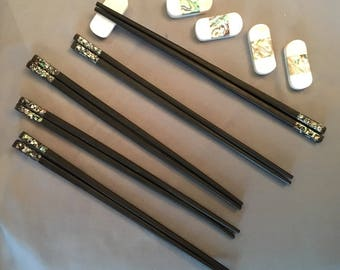 Handmade Vietnamese Ebony chopsticks with Peppered Green Abolone shell accents and chopstick rests. Set of 5