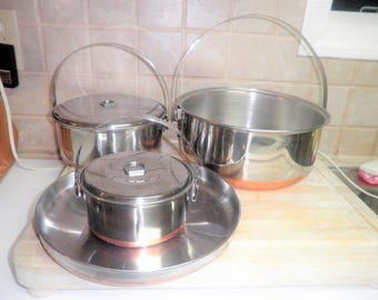 set of 4 Vintage stainless steel pots and pans with handles and lids