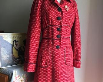 Red and black polkadot peacoat