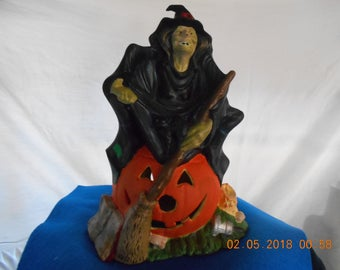 Lighted Witch Sitting on Pumpkin