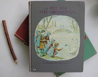 A Pet for the Orphelines, August 1962, Natalie Savage Carlson and Fermin Rocker, The Perfection of Old Library Books