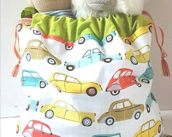 Handy pouch in a car print design with a draw string great for storing nappies and toys for your trips out, nappy bag
