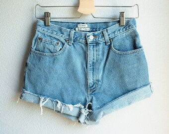 Vintage high-waisted light wash denim cut-offs