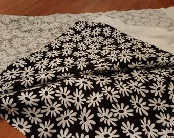 Printed Knit Fabric of White Flowers (Daisies) and Black Background