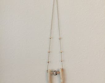 U+ball clay necklace with rose gold metal bead accents